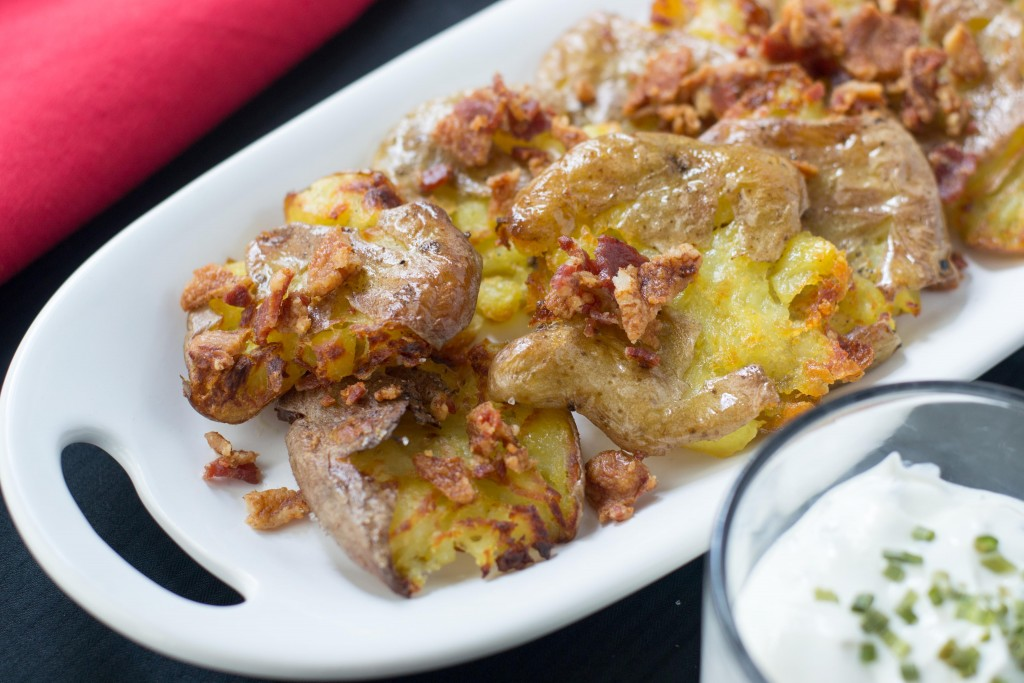 Crispy Smashed Baby Potatoes with Bacon Bits and Chive Sour Cream ...